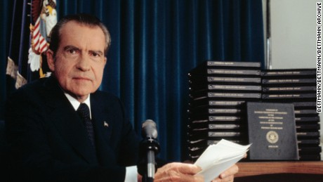 "(Original Caption) President Richard Nixon said he will turn over 1,200 pages of edited transcripts about Watergate scandal to the House Judiciary Committee that, he said, would clear him of any involvement and will ""tell it all"". The stack of transcripts to be turned over are in the background."