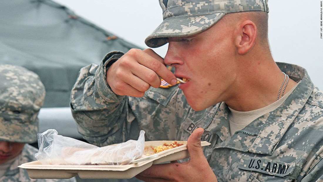 Food served in the field must be as nutritious as that served back at base, and the military says it makes sure it's also tasty by conducting frequent field tests. Health care specialist Earl Buelow eats a forkful of scrambled eggs and salsa during a heat-and-serve menu testing at Fort Riley, Kansas.
