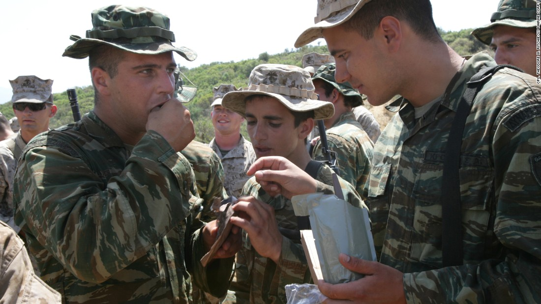 The Department of Defense says it's proud of the meal offerings for combat troops in the field. Here, members of the 22nd Marine Expeditionary Unit offer Greek soldiers a chance to taste MREs at a training area outside Volos, Greece.  <br />