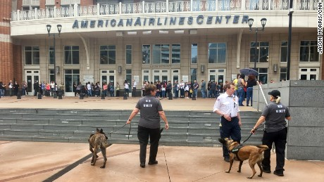 Officers outside a New Kids On The Block concert in Dallas on Tuesday include bomb-sniffing dogs.