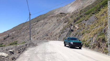 Saturday's Mud Creek slide left a pile of earth about 35 to 40 feet high covering the highway.