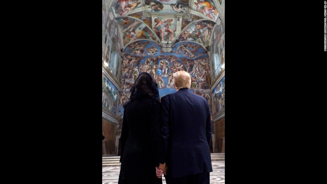 Trump and his wife look at the ceilings of the Sistine Chapel.