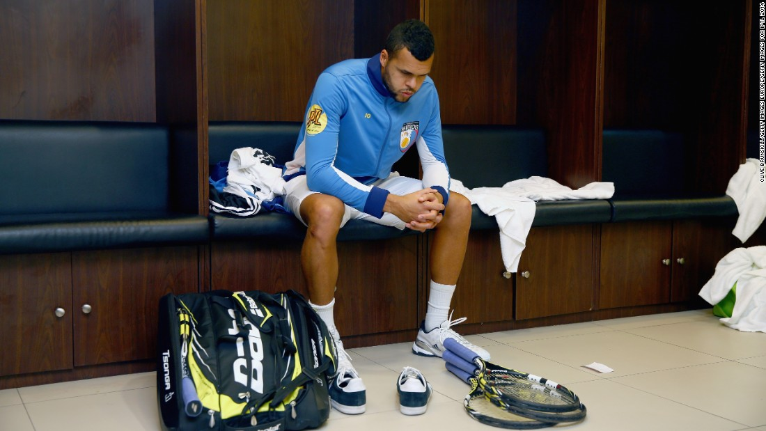"""There is such a thing as locker room power,"" former British Davis Cup player Arvind Parmar told CNN Sport.  Here Frenchman Tsonga of the Manila Mavericks gets ready in the locker room before his team's match against the Singapore Slammers during the Coca-Cola International Premier Tennis League at the Mall of Asia Arena in November 2014."