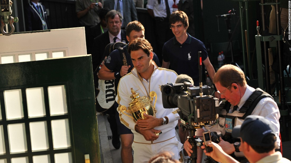 Switzerland's Roger Federer is filmed by a TV crew holding the Wimbledon trophy as he enters the dressing room after beating Andy Roddick of the US in the 2009 final. Federer has opted not to play at this year's French Open.