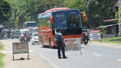A police officer mans a checkpoint on a highway in Iligan City on the southern island of Mindanao on May 24.