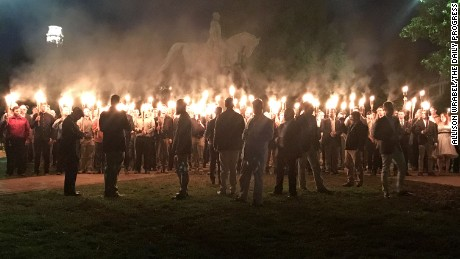 A group of torch-wielding protesters gathered in a Charlottesville park recently to protest the planned removal of a statue Gen. Robert E. Lee.