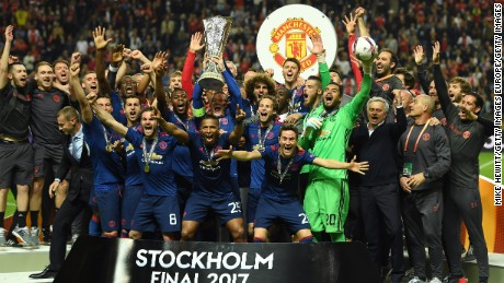 Club captain Wayne Rooney lifts trophy as United's players celebrates a first Europa League title for the club