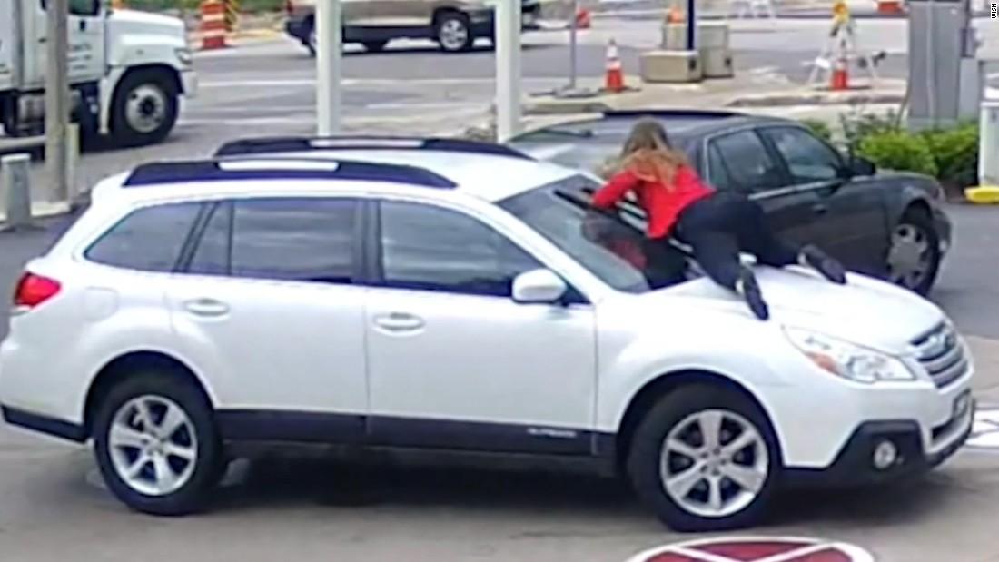 Woman Jumps On Car Hood As Thief Drives