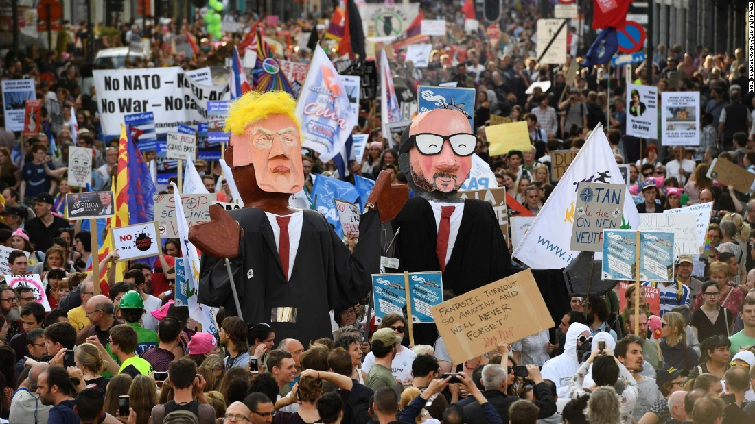 Protesters in Brussels demonstrate with effigies of Trump and Michel on May 24.