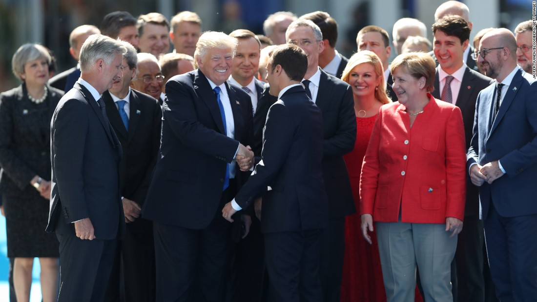 "Trump shakes hands with Macron in Brussels, Belgium, on Thursday, May 25. They were attending <a href=""http://www.cnn.com/2017/05/25/politics/trump-nato-financial-payments/"" target=""_blank"">a NATO summit</a> as the alliance officially opened a new $1 billion headquarters."