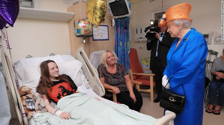 Queen Elizabeth II speaks to Millie Robson, 15, and her mother, Marie, during a hospital visit to meet victims of the terror attack in Manchester.