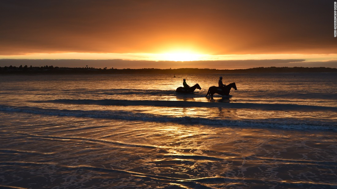 <strong>Warrnambool, Australia: </strong>Horses and riders walk on Lady Bay beach ahead of the Warrnambool Racing Carnival on May 3, 2017.