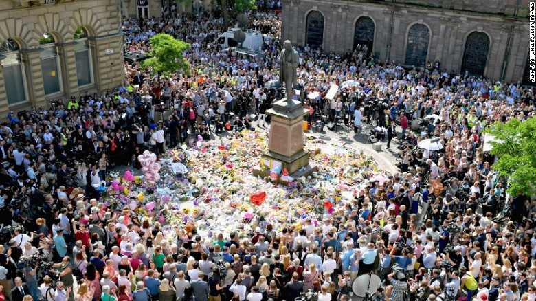 """People in Manchester, England, gather in St. Ann's Square on Thursday, May 25. They were observing a national minute of silence to remember <a href=""""http://edition.cnn.com/2017/05/23/europe/manchester-attack-victims/index.html"""" target=""""_blank"""">the victims </a>of a suicide bombing at an Ariana Grande concert."""