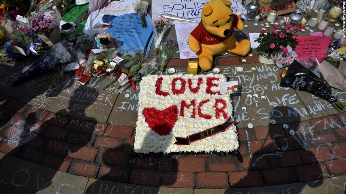 Flowers and tribute messages are left for victims in St. Ann's Square.