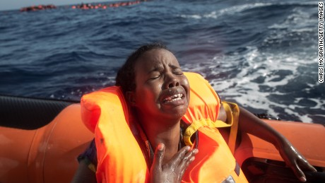 A woman cries after losing her baby as she sits in a rescue boat on May 24, 2017 off Lampedusa, Italy.