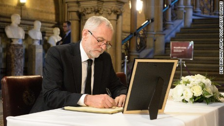 Labour leader Jeremy Corbyn signs a book of condolence at Manchester Town Hall on Tuesday.