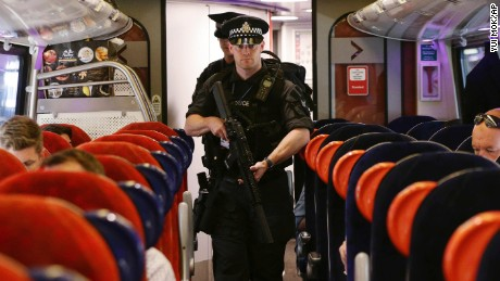 Armed police officers are patroling on board trains nationwide for the first time.
