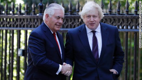 UK Foreign Secretary Boris Johnson (R) greets US Secretary of State Rex Tillerson in London.