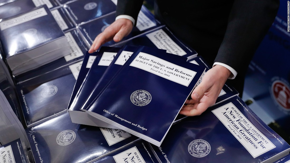 "Copies of President Trump's new budget proposal are laid out before being distributed to congressional staffers in Washington on Tuesday, May 23. <a href=""http://www.cnn.com/2017/05/23/politics/trump-budget-cuts-programs/"" target=""_blank"">Trump's budget by the numbers: What gets cut and why</a>"