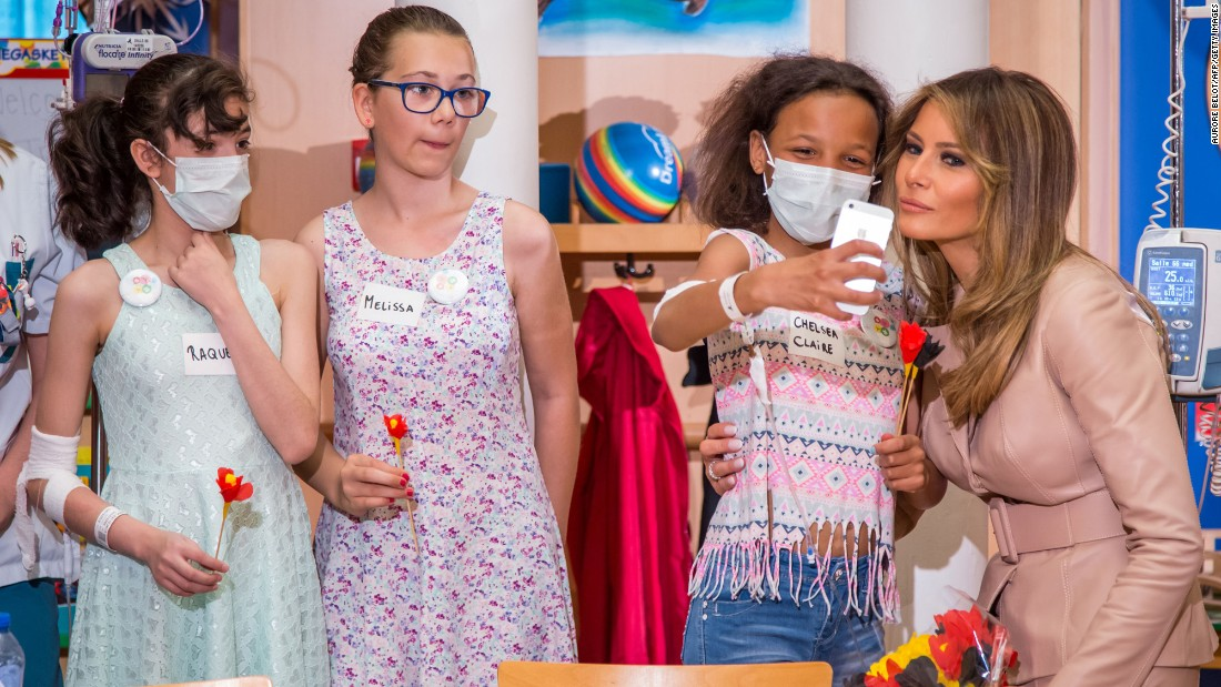 A girl takes a selfie with first lady Melania Trump at a children's hospital in Brussels, Belgium, on Thursday, May 25.