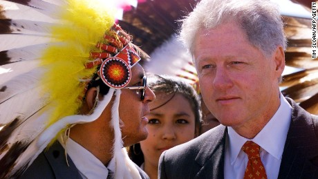 President Bill Clinton listens to Oglala Sioux Nation President Harold Salway on July 7, 1999, at Pine Ridge Indian Reservation.