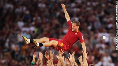 AS Roma players hold up Francesco Totti after his last match for the club.