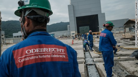 Workers of Brazilian construction company Odebrecht build the new Brazilian naval submarine base in Itaguai, some 70 km south from Rio de Janeiro, Brazil, on April 7, 2017.  The first Brazilian conventional submarines (SSK) are manufactured under the national submarine development program (Prosub) in partnership with France. / AFP PHOTO / YASUYOSHI CHIBA        (Photo credit should read YASUYOSHI CHIBA/AFP/Getty Images)