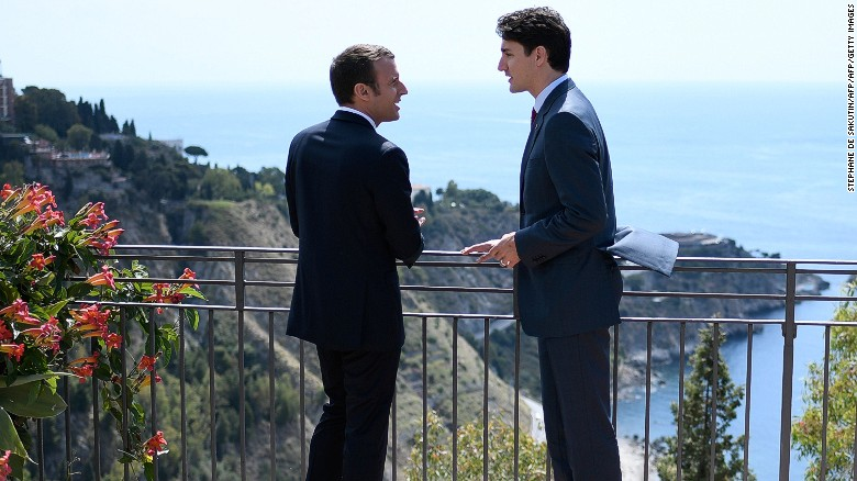 Canadian Prime Minister Justin Trudeau (R) and French President Emmanuel Macron talk as they attend the Summit of the Heads of State and of Government of the G7, the group of most industrialized economies, plus the European Union, on May 26, 2017 in Taormina, Sicily. The leaders of Britain, Canada, France, Germany, Japan, the US and Italy will be joined by representatives of the European Union and the International Monetary Fund (IMF) as well as teams from Ethiopia, Kenya, Niger, Nigeria and Tunisia during the summit from May 26 to 27, 2017. / AFP PHOTO / POOL / STEPHANE DE SAKUTIN        (Photo credit should read STEPHANE DE SAKUTIN/AFP/Getty Images)