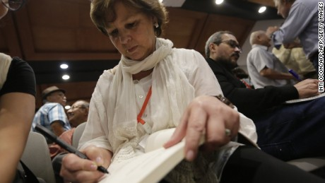 "Colombian writer Piedad Bonnet signs an autograph in a fan´s book during the second day of the Fifth literary festival ""CentroAmérica Cuenta"" dedicated to two great French authors of the twentieth century, André Malraux and Albert Camus in Managua on May 23, 2017. / AFP PHOTO / INTI OCON        (Photo credit should read INTI OCON/AFP/Getty Images)"