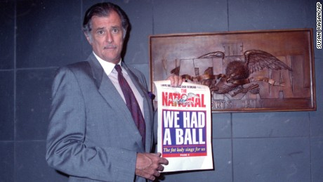 Frank Deford, editor and publisher of The National Sports Daily, holds a proof of the final front page of the newspaper after a news conference at the paper's offices in New York City on Wednesday, June 12, 1991.  He announced that the publication would fold with Thursday's issue.