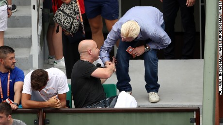 Andre Agassi (left), new coach of Novak Djokovic, speaks with Boris Becker on day two at Roland Garros