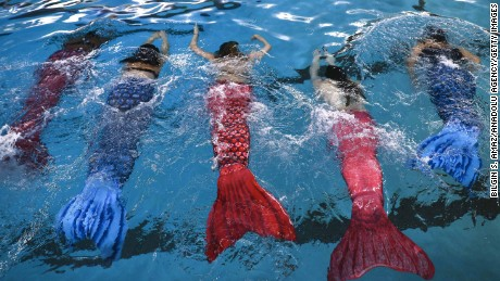 CHICAGO, UNITED STATES - MARCH 19: Women practice swimming with mermaid tails at AquaMermaid swimming school, a mermaid training school in Chicago, United States on March 19, 2017. Participants are fulfilling their lifelong ambitions of becoming mermaids with a new type of fitness mermaid swimming.  (Photo by Bilgin S. amaz/Anadolu Agency/Getty Images)