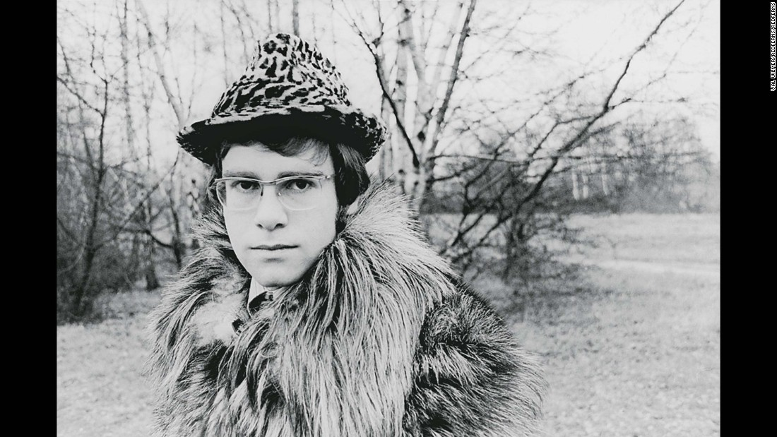 John poses for one of his first publicity photos in 1968. He was born Reginald Kenneth Dwight in Pinner, England. He officially changed his name to Elton John in 1967. The name was inspired by members of his early band, Bluesology. The saxophone player was named Elton Dean, and the lead singer was named Long John Baldry.