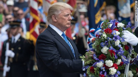 President Donald Trump arrives to lay a wreath at the Tomb of the Unknowns at Arlington National Cemetery to mark Memorial Day in Arlington, Virginia, on May 29, 2017.