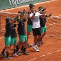 Djokovic  celebrates with the ball boys