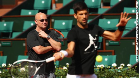 PARIS, FRANCE - MAY 29:  Coach Andre Agassi watches on during a Novak Djokovic training session prior to his match against Marcel Granollers of Spain on day two of the 2017 French Open at Roland Garros on May 28, 2017 in Paris, France.  (Photo by Clive Brunskill/Getty Images)