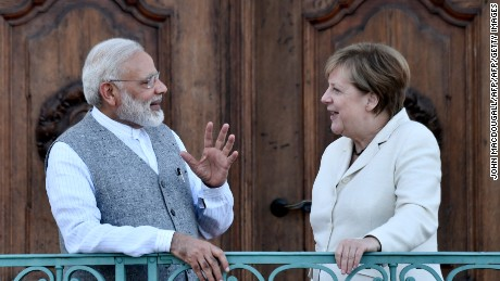 Merkel hailed India's committment to the Paris climate deal after meeting Modi (L) on Tuesday.