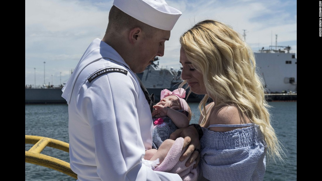 Navy Petty Officer 2nd Class Dylan Bagdasarian says goodbye to his wife and daughter in San Diego before setting off on a scheduled deployment on Monday, May 8.