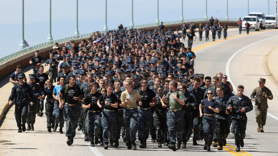 "First-year midshipmen, known as ""plebes,"" run across a bridge Tuesday, May 16, during Sea Trials, a daylong training exercise that caps off their year at the US Naval Academy."