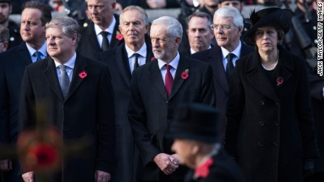 Corbyn stands next to British Prime Minister Theresa May at the annual Remembrance Sunday Service in London last year.