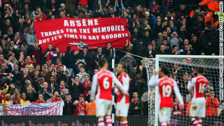 Arsenal fans hold up a banner during the English Premier League match between West Bromwich Albion and Arsenal at The Hawthorns on November 29, 2014