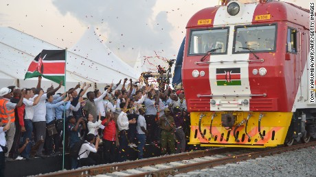 People cheering in Mombasa, at the inaugural journey on a train line that will run to Nairobi.