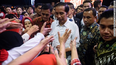 Indonesian President Joko Widodo (C) meets Indonesian workers during an event in Hong Kong on April 30.