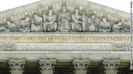 "WASHINGTON - JUNE 29:  ""Equal Justice Under Law"" is carved into the facade of the United States Supreme Court building June 29, 2009 in Washington, DC."