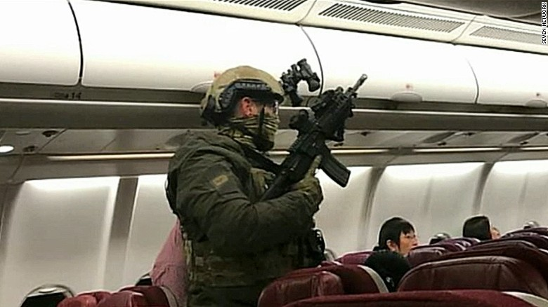 Moment man is detained aboard Malaysia flight