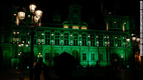 A picture taken Thursday shows the City Hall of Paris illuminated in green following Trump's decision.