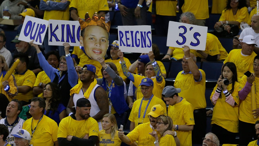 Fans hold up signs for Curry during the second half of Game 1.