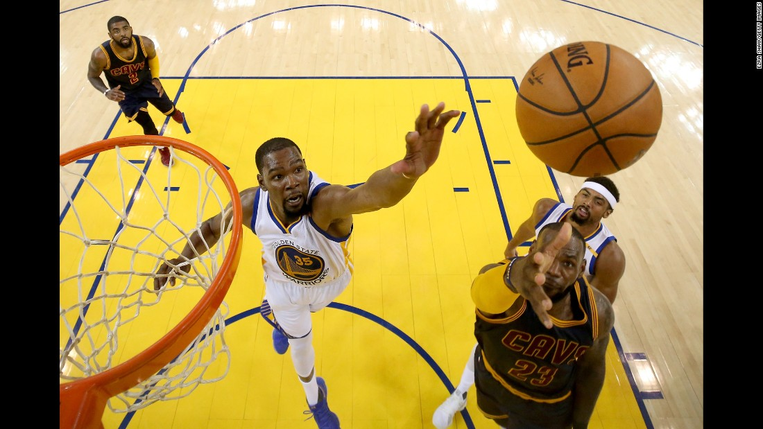 James goes up for a shot against Durant during the first game on Thursday, June 1. Durant scored a game-high 38 points for the Warriors, who opened the Finals with a dominating 113-91 victory.