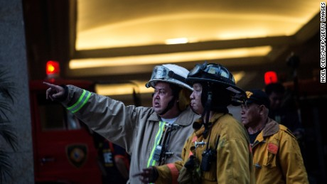 Firemen arrive at the Resorts World Hotel following an assault in Manila on June 2, 2017. Thirty-four bodies were found in a casino complex after a gunman started a fire in the building, the local police chief said. / AFP PHOTO / NOEL CELIS        (Photo credit should read NOEL CELIS/AFP/Getty Images)
