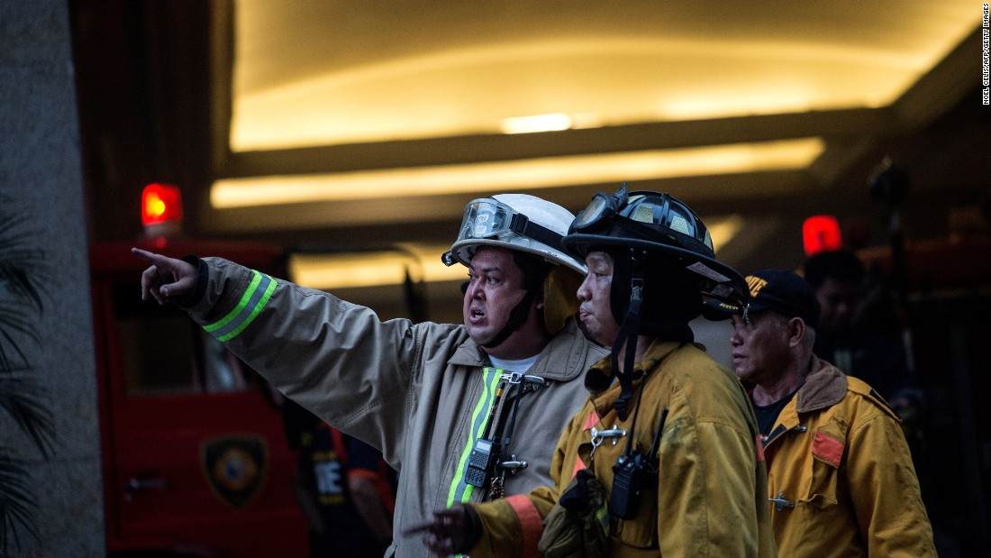 Firemen arrive at the Resorts World Hotel.